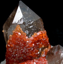 Spessartite on smoky quartz